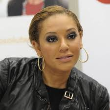 Former SPICE GIRLS star MELANIE BROWN wants her former bandmates to come together in 2014 to ... - 451144_1
