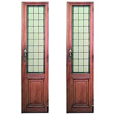 pair of american mission oak framed doors with tinted leaded glass panels for