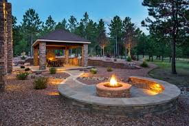 this outdoor fire pit is constructed from a steel frame encased by a fire ant inorganic material or magnesium composite which gives it a