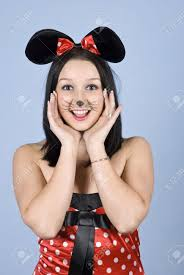 happy with mouse costume and makeup holding hands to face and say o