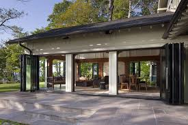 nanawall s sliding glass walls integrate this dining room with the surrounding patio and landscape photo
