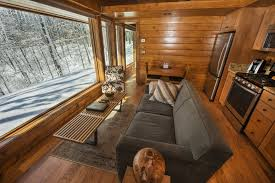 a park model rv that looks like an escape cabin