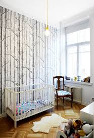 nursery with black and white woodland wallpaper