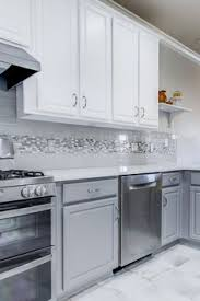 white and grey kitchen backsplash. Modren Grey We Brought This Kitchen Up To Date By Painting The Existing Cabinets White  On Top And With White And Grey Kitchen Backsplash K