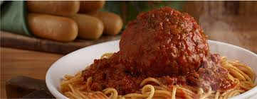 giant meatball with spaghetti topped with homemade meat sauce