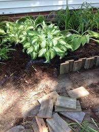 eleven interesting garden bed edging ideas pallet wood pallets in pallet wood garden edging
