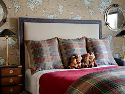 kids bedroom with map wallpaper and plaid bedding