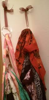 Old shower curtain rings tied together with ribbon are perfect for hanging  scarves, bandanas, belts, etc.