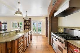 the kitchen features walnut finished cabinetry as well