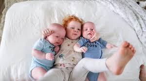 Big sister WILL NOT let go of TWIN brothers *ADORABLE*