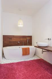minimalistic pendant light above bathtub and even if you