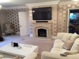 interior white sofa design with mounting tv above fireplace also also tv above fireplace