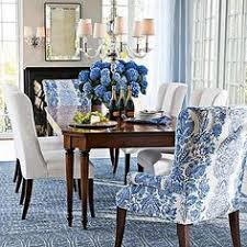 blue and white dining room with great head chairs i like the idea of having two diffe head chairs perhaps two nice head chairs that are cloth covered