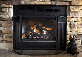 traditional firescreens consist of a black three paneled wrought iron frame