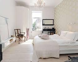 set design scandinavian bedroom. Bedroom:Cool Scandinavian Bedroom Decor With White Fabric Bedsheet And Beautiful Chandelier Also Modern Wallpaper Set Design G