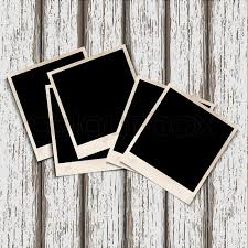 old photo frames on old wooden background vector