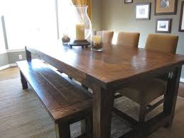 a farmhouse dining table with brown chairs