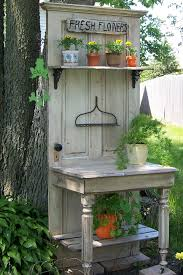 you can make this from an old door half a table and the metal part of a rack it makes a nice accent in the corner of our yard between two flower beds