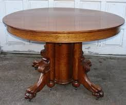 round 48 in antique oak claw foot dining table 5 legs