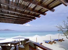 A garden walkway leads down from the pool to the beach and the Amanpulo  Beach Club.