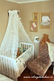 Lacy curtain canopy over crib. Love love this canopy! But it would can't be  great put agents a white wall, which is all I have : (.