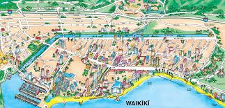 holiday inn waikiki beachcomber resort is the yellow building in