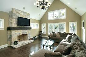 brown furniture wall color brown living room walls vaulted ceiling and sculpted metal chandelier hang above a wide expanse of brown furniture wall color