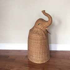 miraculous natural rattan design in Elephant wicker Hamper Jambon style  standing on natural wooden laundry room