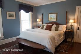 king bed with tub shower original room to the house fireplace television small balcony overlooking the gardens 190 225