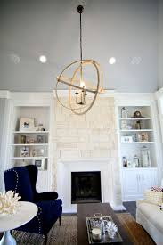 interior fantastic living room decoration using vintage white fireplace orbital chandelier including indoor stone and light grey wall paint great exterior