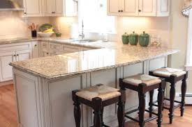 u shaped kitchen with breakfast bar white granite countertop material wooden seat bars white kitchen storage