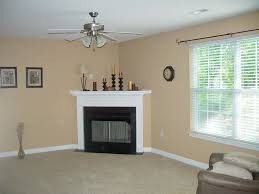decorations good looking corner fireplace decor with beige wall color and fan ceiling idea fascinating