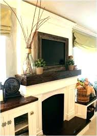 tv on fireplace mantel above mantel wooden frame around mantle mount fireplace tv over fireplace mantel tv on fireplace