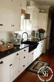 kitchens to go snegable ur with white cabinets and granite countertops