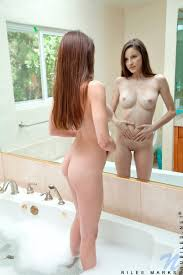 Petite teen uncovers firm tits before masturbating in bathtub.