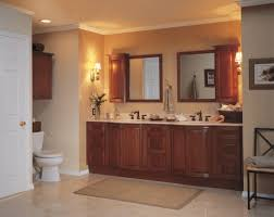 beige wall color and chic cherry wall cabinet using sparkling mirror for formal styled bathroom plan