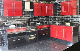 Red High Gloss. This red and black high gloss kitchen complete oven .