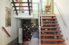 View in gallery Awesome contemporary wine cellar under the sleek staircase  [From: Wakefield Construction / First Impressions
