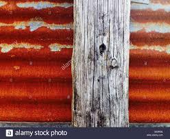 rusted corrugated metal fence. Beautiful Corrugated Wooden Post And Rusty Corrugated Iron Fence Throughout Rusted Corrugated Metal Fence