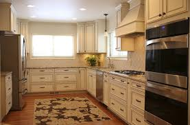 White Wood Range Hood With Recessed Lighting And Square Rug For Vintage Kitchen  Decorating Ideas