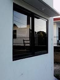 aluminum sliding window in oc frame 6 mm bronze glass with complete accessories and installation