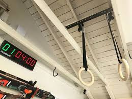 stop worrying about where to hang your rings the rogue ring hanger is the perfect solution for hanging your gymnastics ring in your garage or facility