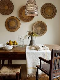 View in gallery Beautifully arranged African baskets in the dining room