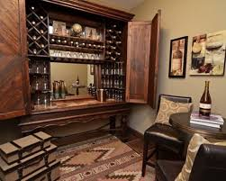 home bar design. view in gallery space conscious home bar closes up into a cabinet design