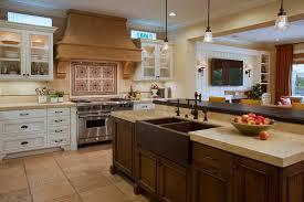orange county dark wood countertops with traditional mosaic tiles kitchen mediterranean and beige stone floor copper