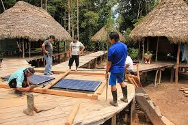 photo essay installing solar panels at tiinkias ecolodge  framing solar panels for installation at achuar ecolodge in ean amazon