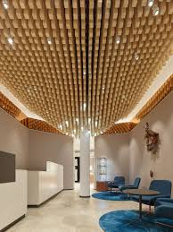 4362 square wooden dowels cover the ceiling of this watch showroom
