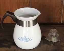 This fabulous austrian enamel coffee pot features mod 1960s decorations. Vintage Pyrex Coffee Pot