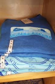 the guy harvey line of apparel includes shirts featuring various forms of marine life hats belts shorts footwear and gift items