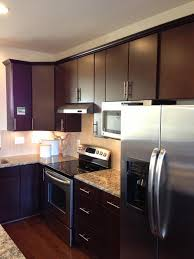 remodeled kitchen in urbana with black cabinets white counter top and light back splash